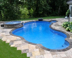 Inground pool surrounded with patio stones