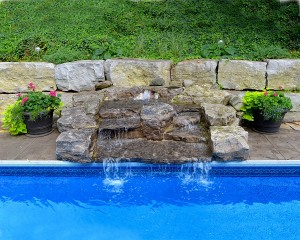 Inground pool with water cascade