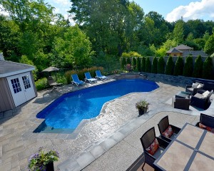 Inground pool with large patio area