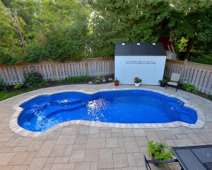 Vinyl lined inground pool with patio area