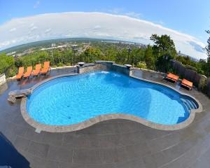 Vinyl lined inground pool with escarpment view