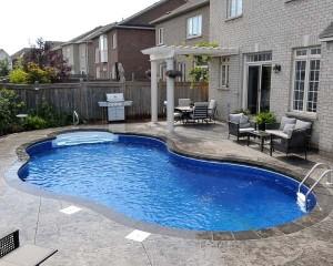 Inground pool with dark blue liner
