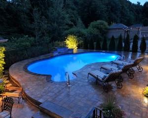 Inground swimming pool at night